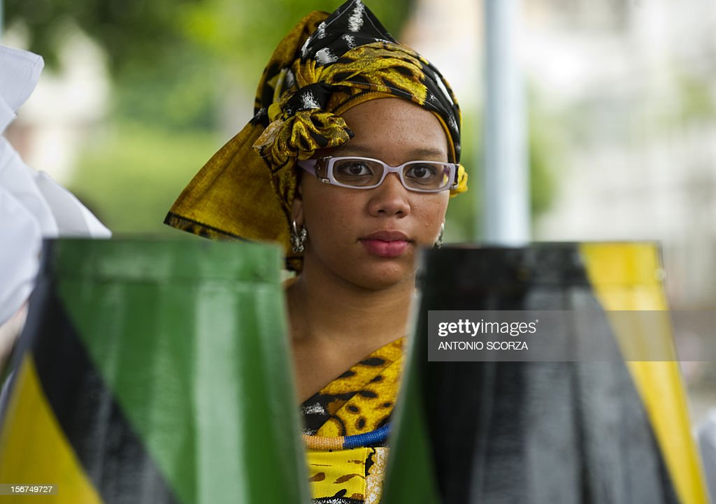 An African-Brazilian woman takes part in a celebration for the Black Conscience Day on November 20, 2012 in Rio de Janeiro, Brazil.