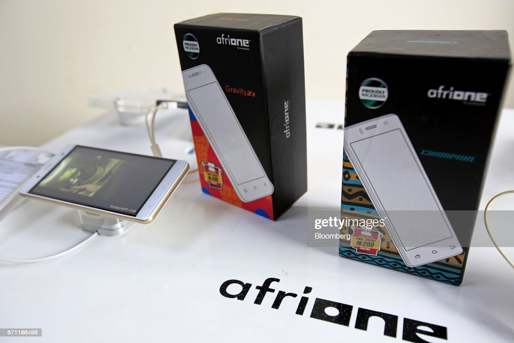 An AfriOne Gravity Z1 smartphone sits on display during a launch event at the new AfriOne Ltd. manufacturing plant in Lagos, Nigeria, on Friday, April 21, 2017. The plant has the capacity to produce some 120,000 units per month. Photographer: George Osodi/Bloomberg via Getty Images