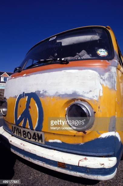 An ageing Volkswagen Type 2 campervan featuring a hand painted CND logo and owned by surfers Newquay United Kingdom 1994