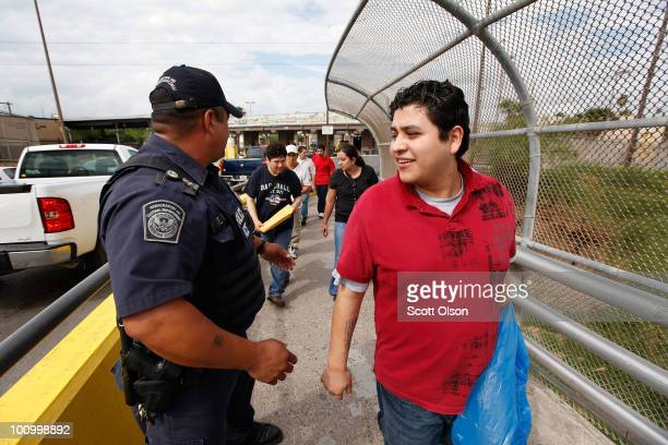 An agent from US Immigration and Customs Enforcement watches as Alberto OrtizHernandez walks into Mexico May 25 2010 in Brownsville Texas Hernandez...