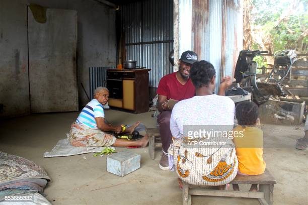 An agent of the census services meet inhabitants of La Vigie in PetiteTerre on the Mozambique channel French archipelago of Mayotte on September 22...