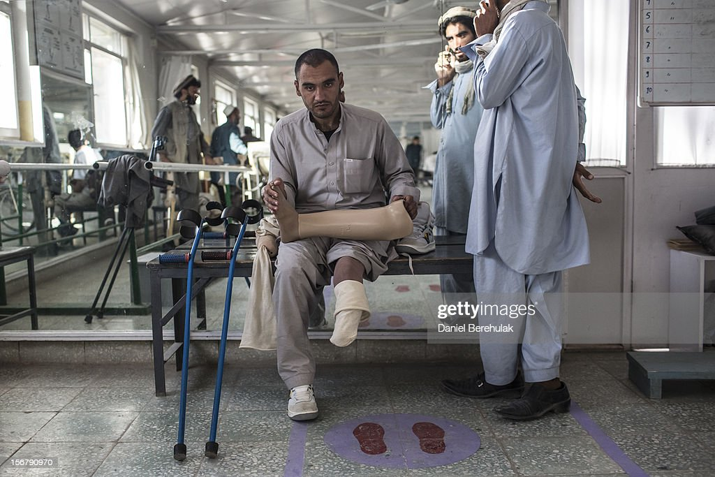 An Aghan man sits holding his prosthetic limb as he waits for a fitting with a specialist at the International Committee of the Red Cross (ICRC) orthopedic centre on November 20, 2012 in Kabul, Afghanistan. The ICRC rehabilitation centre works to educate and rehabilitate land-mine victims, and those with limb related deformities, back into society and employment offering micro-credit financing, home schooling and vocational training to patients. The clinic itself is unique in that all of the workers are handicapped. The ICRC centre in Kabul has registered over 57,000 patients and 114,000 countrywide in all of their centres since its inception 25 years ago.