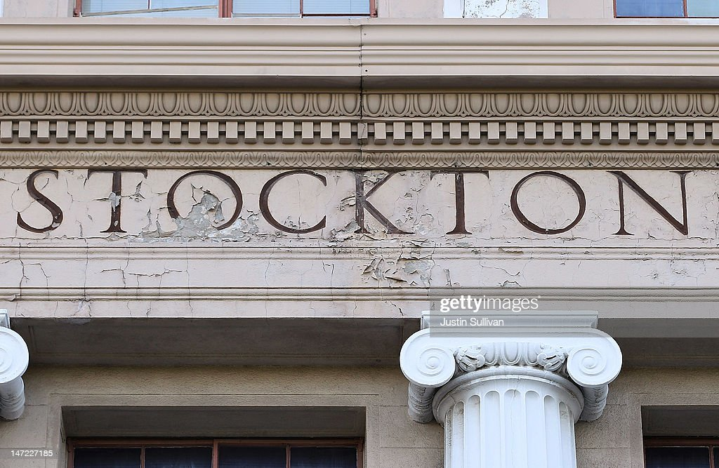An aging sign is seen at Stockton City Hall on June 27, 2012 in Stockton, California. Members of the Stockton city council voted 6-1 on Tuesday to adopt a spending plan for operating under Chapter 9 bankruptcy protection following failed talks with bondholders and labor unions failed. The move will make Stockton the biggest U.S. city to file for bankruptcy protection from creditors.