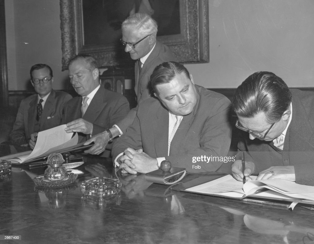 An agreement between the British and West German governments for peaceful cooperation over the use of atomic energy Signing the agreement at the...