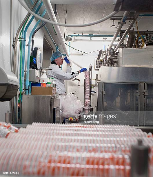 An AgroFarma Inc employee stocks the yogurt filling machine with Chobani Inc containers at a facility in New Berlin New York US on Tuesday Jan 31...