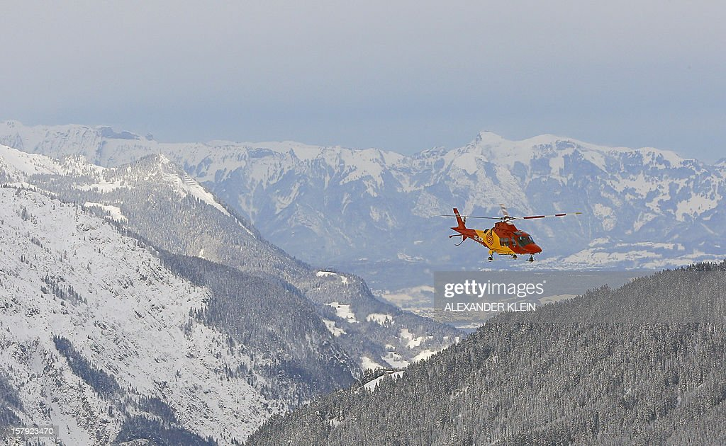 An Agusta Westland AW109 SP search and rescue helicopter flies for a ski medical assistance in the mountains of Schruns Montafon on December 7, 2012.