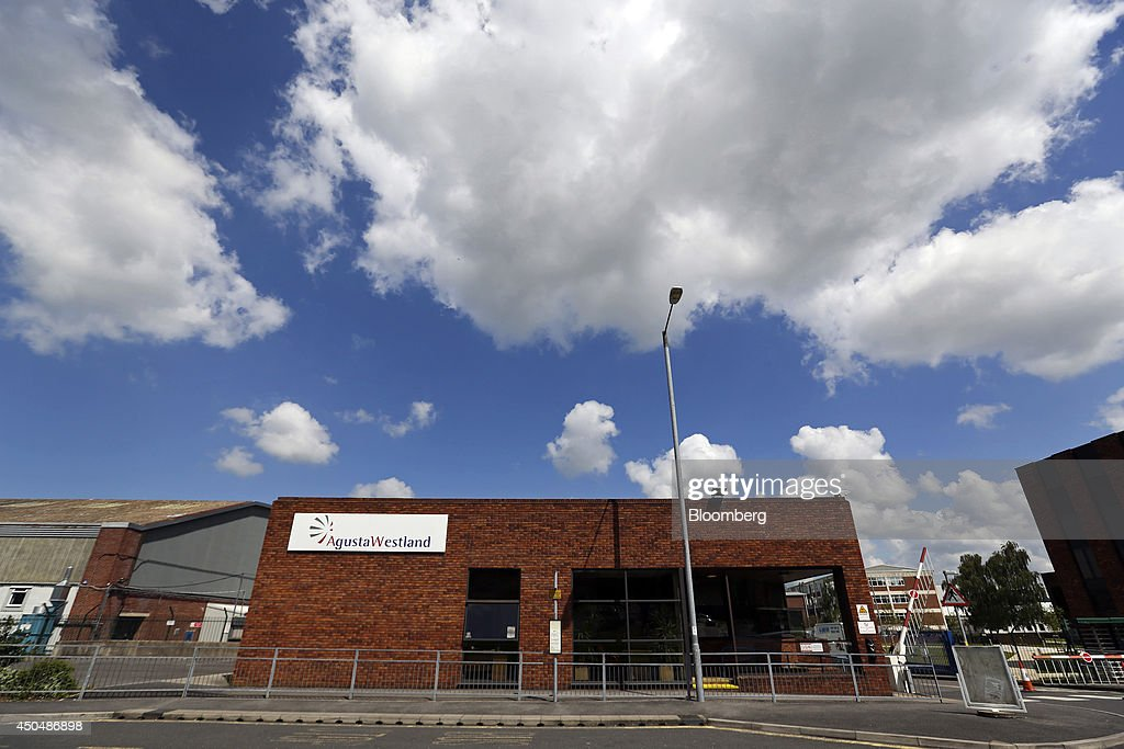 An AgustaWestland logo sits on a sign above the entrance to the company's plant, a unit of Finmeccanica SpA, in Yeovil, U.K., on Thursday, June 12, 2014. U.K. unemployment declined more than expected and industrial production rose at the fastest annual pace since 2011, according to reports released this week. Photographer: Chris Ratcliffe/Bloomberg via Getty Images