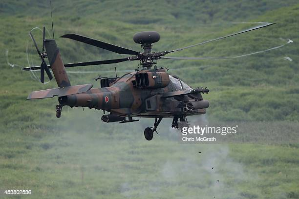 An AH64D 'Apache' attack helicopter fires during the Japan Ground SelfDefense Force annual live fire exercise at East Fuji Maneuver Area on August 19...
