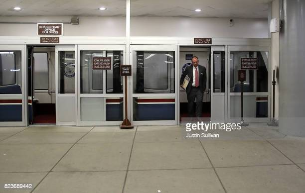 An aide steps off the Senate subway as he walks to the US Capitol before allnight voting July 27 2017 in Washington DC Senate Republicans are working...