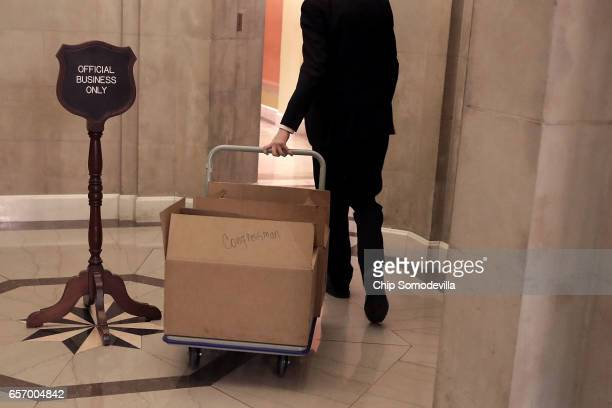 An aide wheels a cart full of Italian food into the office of Speaker of the House Paul Ryan at the US Capitol March 23 2017 in Washington DC Ryan...
