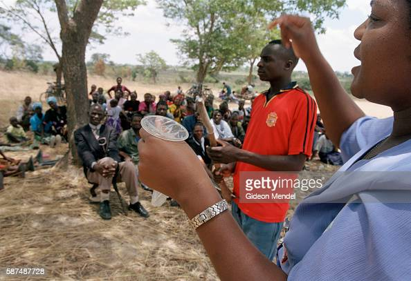 An AIDS educator demonstrates the female condom to villagers during a daylong programme run by Mumuni a nongovernmental organisation Villagers are...