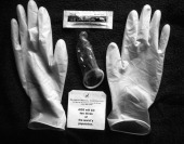 An AIDS protection pack from the Rajneesh Medical Corporation containing latex gloves a condom and HR lubricating jelly Oregon USA circa 1984 This...