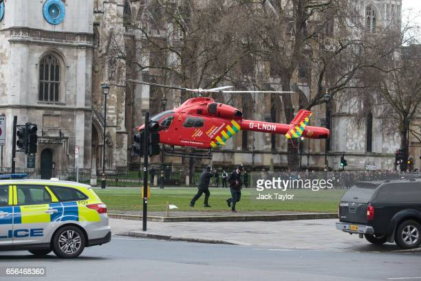 An Air Ambulance at the scene by Westminster Bridge and the Houses of Parliament on March 22 2017 in London England A police officer has been stabbed...
