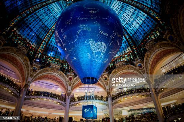 An air balloon is displayed during an exhibition to celebrate the 70th anniversary of the Christian Dior brand at the Galeries Lafayette Haussmann in...