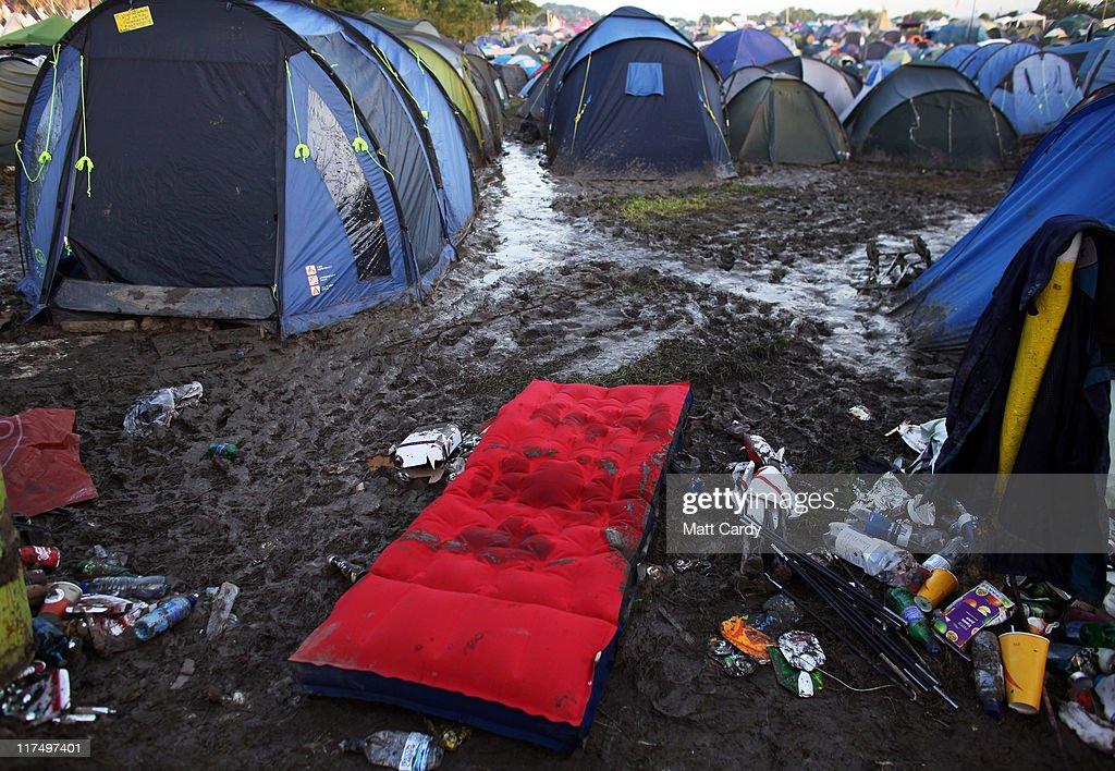 An air bed and empty tents litter the Glastonbury Festival site at Worthy Farm, Pilton on June 27, 2011. As the 140,000 plus music fans began to leave this morning the clean up of the 1000s of tonnes of rubbish left by them begins. The festival, which started in 1970 when several hundred hippies paid 1 GBP to watch Marc Bolan, has grown into Europe's largest music festival attracting more than 175,000 people over five days.