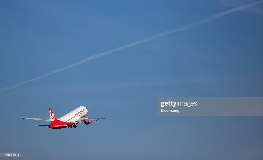An Air Berlin aircraft flies from Tegel airport, operated by Flughafen Berlin Brandenburg GmbH, in Berlin, Germany, on Wednesday, March 12, 2014. Berlin's Tegel airport has subsisted by chance alone, defying the odds as passenger growth outpaces every other major hub in Western Europe. Photographer: Krisztian Bocsi/Bloomberg via Getty Images