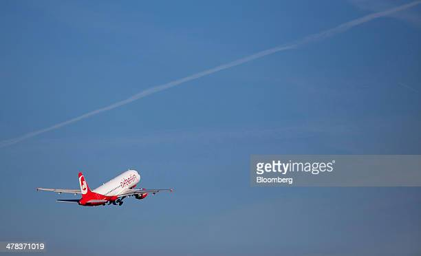 An Air Berlin aircraft flies from Tegel airport operated by Flughafen Berlin Brandenburg GmbH in Berlin Germany on Wednesday March 12 2014 Berlin's...