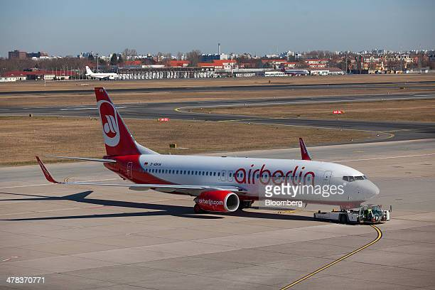 An Air Berlin aircraft is towed on the tarmac at Tegel airport operated by Flughafen Berlin Brandenburg GmbH in Berlin Germany on Wednesday March 12...