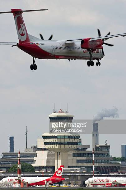 An Air Berlin aircraft lands at Berlin's Tegel airport May 15 2012 Air Berlin Germany's second largest airline said it had reduced its net loss in...
