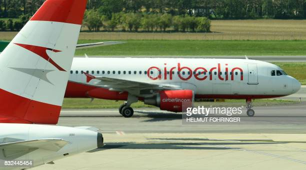 An Air Berlin airplane is seen on the tarmac at the airport in Vienna on August 16 2017 Germany's struggling budget airline Air Berlin on August 15...