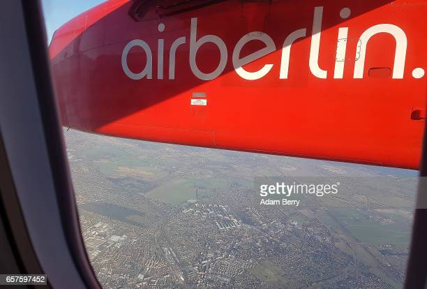 An Air Berlin logo is seen on one of the company's airplanes as it takes off from Tegel airport on March 24 2017 in Berlin Germany Air Berlin PLC Co...