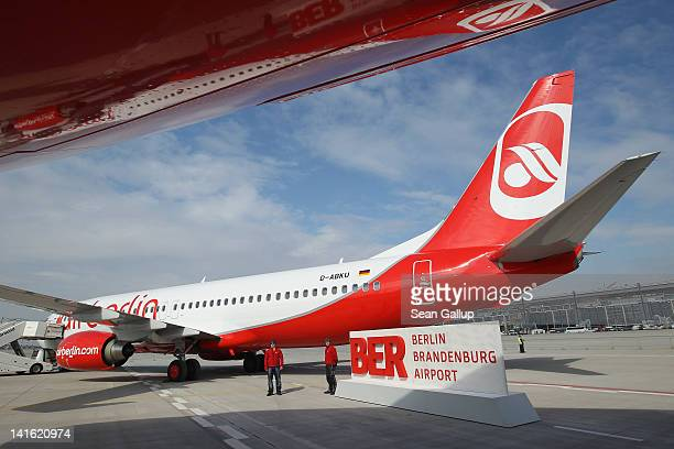 An Air Berlin passenger plane stands on the tarmac at Willy Brandt Berlin Brandenburg International Airport during a promotional event on March 20...