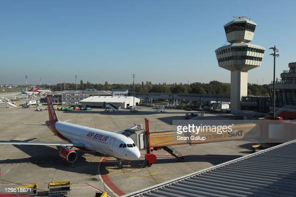 An Air Berlin passenger plane stands on the tarmac near the control tower at Tegel Airport on October 17 2011 in Berlin Germany Tegel which first...