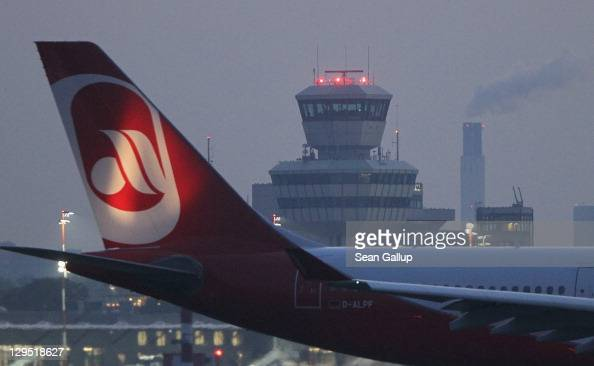 An Air Berlin passenger plane taxis for takeoff near the control tower at Tegel Airport on October 17 2011 in Berlin Germany Tegel which first went...