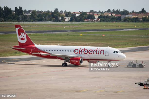 An Air Berlin plane is pictured at Tegel Airport on August 8 2017 in Berlin / AFP PHOTO / AXEL SCHMIDT