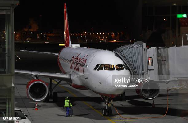 An Air Berlin plane parks at a gate at Munich International Airport on October 27 2017 near Munich Germany Flight AB 6210 is the last Air Berlin...