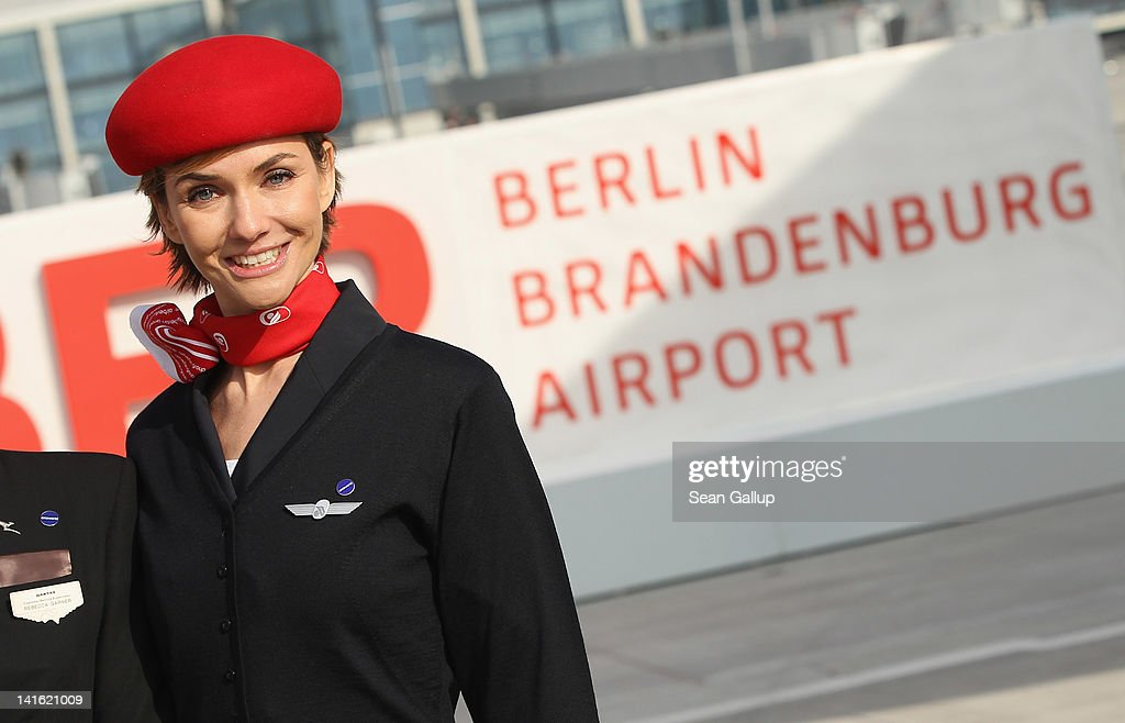 An Air Berlin stewardess stands on the tarmac at Willy Brandt Berlin Brandenburg International Airport during a promotional event on March 20, 2012 in Berlin, Germany. The new airport, which will replace the city's current Tegel and Schoenefeld airports, will officially open in May and begin operation on June 3.