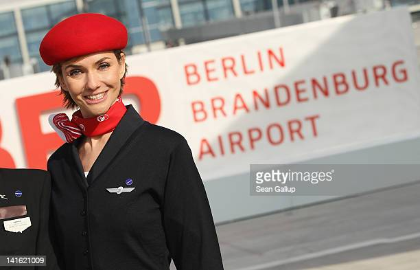 An Air Berlin stewardess stands on the tarmac at Willy Brandt Berlin Brandenburg International Airport during a promotional event on March 20 2012 in...