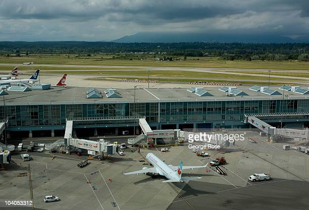 An Air Canada Embraer 190 jet aircraft taxis to a Vancouver International Airport gate on July 7 2010 in Vancouver British Columbia Canada Vancouver...