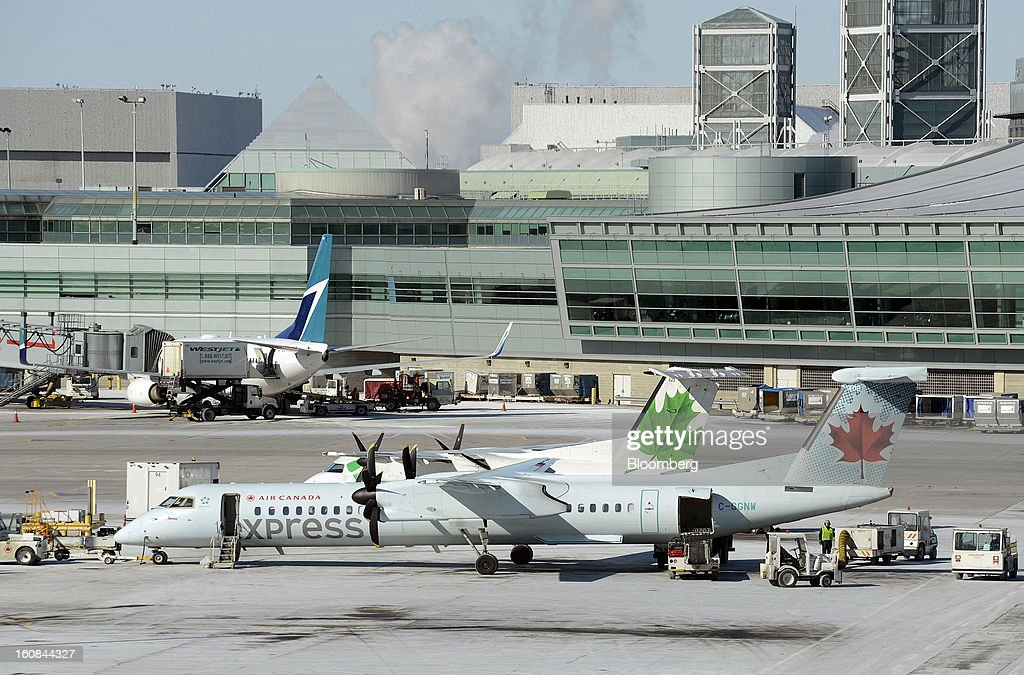 An Air Canada express airplane sits on the tarmac at Pearson International Airport in Toronto, Ontario, Canada, on Wednesday, Feb. 6, 2013. Air Canada, the country's biggest carrier, is scheduled to announce quarterly earnings data on Feb. 7. Photographer: Aaron Harris/Bloomberg via Getty Images