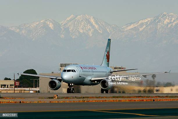 An Air Canada jet lands near where a new lighting system warning pilots of potential runway hazards is to be installed at Los Angels International...