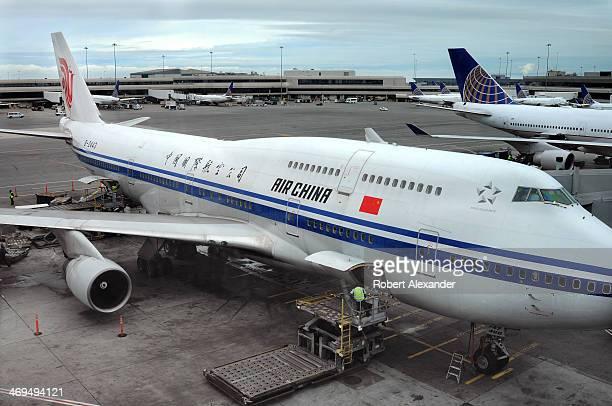 An Air China Boeing 747 aircraft is serviced at the gate at San Francisco International Airport in San Francisco California