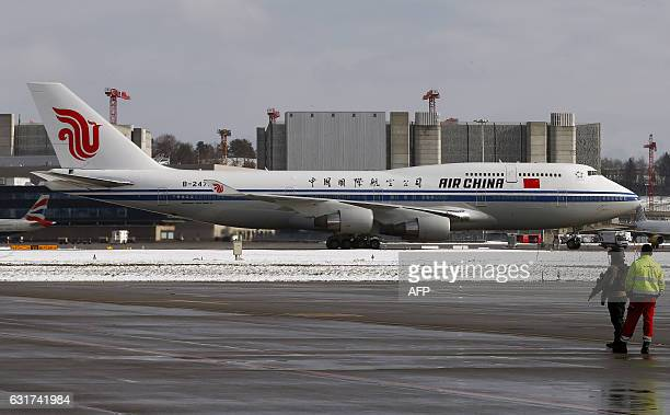 An Air China Boeing 7474J6 aircraft arrives with Chinese President Xi Jinping onboard at Zurich international airport Switzerland on January 15 2017...