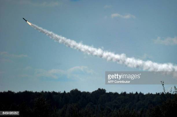 TOPSHOT An air defence system missile flies towards a mock enemy target during the joint RussianBelarusian military exercises Zapad2017 at a training...