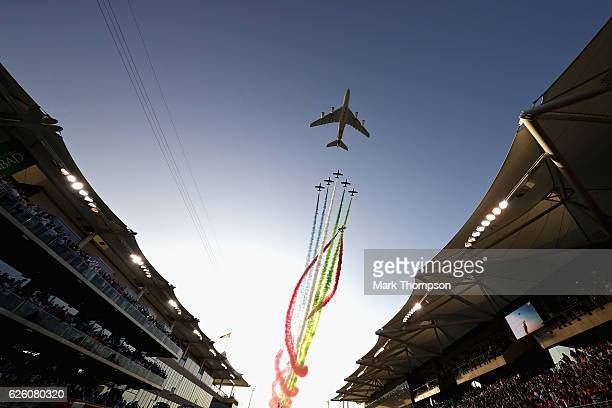 An air display over the grid before the Abu Dhabi Formula One Grand Prix at Yas Marina Circuit on November 27 2016 in Abu Dhabi United Arab Emirates