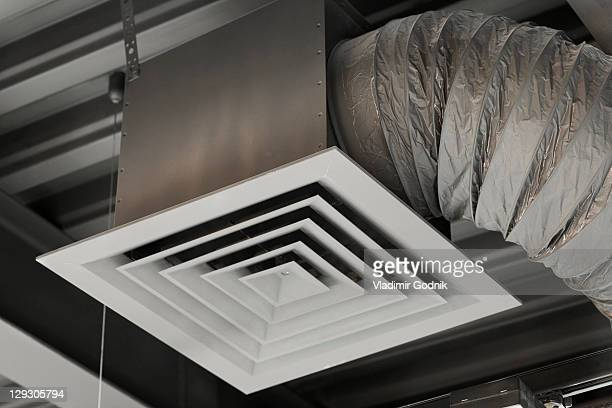 An air duct hanging from a ceiling, close-up, low angle view