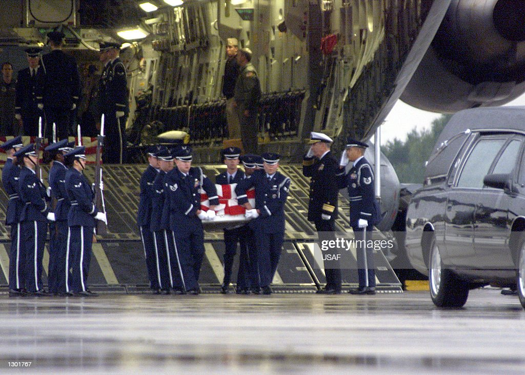 An Air Force Honor Guard carrys the remains of a sailor from an Air Force transport plane October 13, 2000 at Ramstein Air Force Base in Germany. The sailor was killed in a suspected terrorist attack on the USS Cole October 12, 2000 in the Yemen port city of Aden. At least seven are confirmed dead in the attack with another 10 missing. In addition to the dead, 33 others were injured.