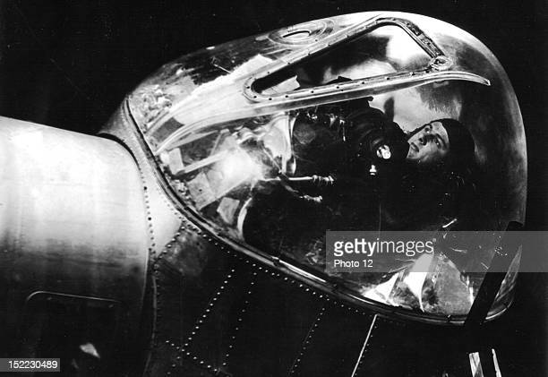 An Air Force lieutenant is seen at his post in the lead plane of an 8th US Air Force flight about to take off for a raid on enemy territory He is a...