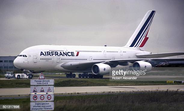 An Air France Airbus A380 aircraft is towed toward the runway at Charles de Gaulle Airport in Paris France The A380 is the world's largest commercial...