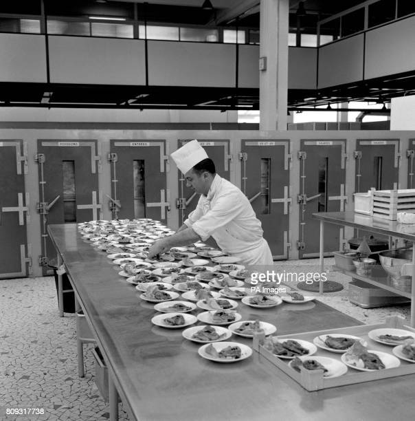 An Air France chef pictured at work in the kitchens among the most modern in the world at the time where meals are prepared for the airline's...
