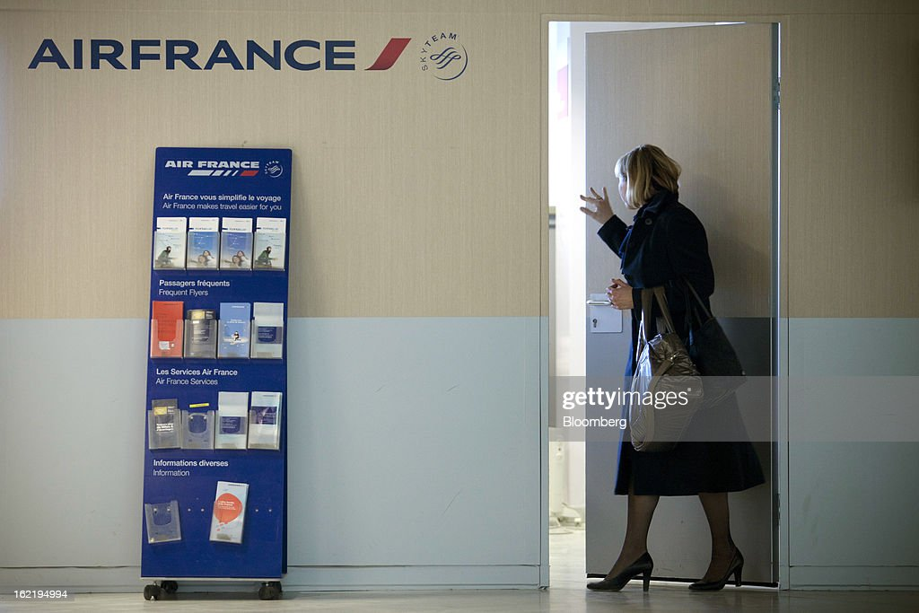 An Air France employee enters the company's office, part of the Air France-KLM Group at Toulouse-Blagnac airport in Toulouse, France, on Tuesday, Feb. 19, 2013. Air France-KLM, Europe's biggest airline, has been revamping its regional operations in an effort to end years of losses. Photographer: Balint Porneczi/Bloomberg via Getty Images