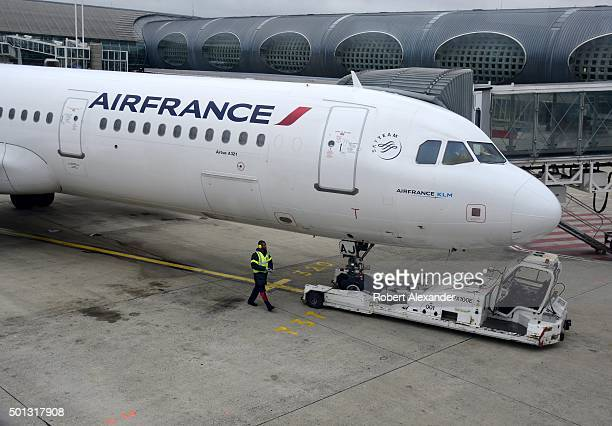 An Air France passenger aircraft arrives at the gate at Charles de Gaulle Airport in Paris France