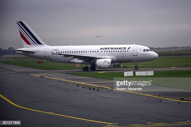 An Air France passenger aircraft taxis toward the runway at Charles de Gaulle Airport in Paris France