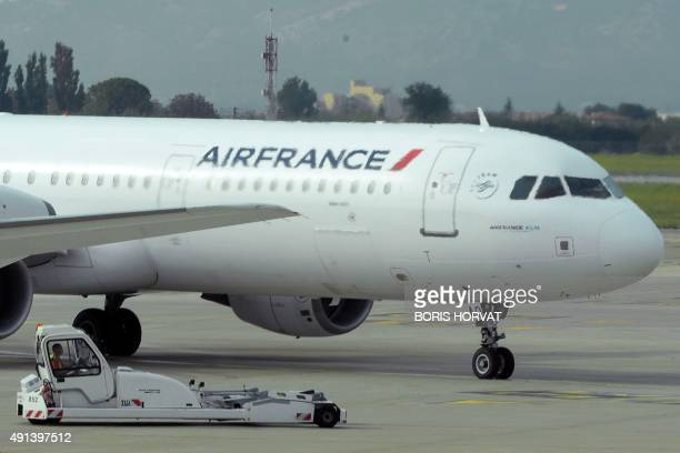An Air France plane is pictured on the tarmac of the MarseilleProvence airport on October 5 2015 in Marignane as Air FranceKLM unveiled a revamped...