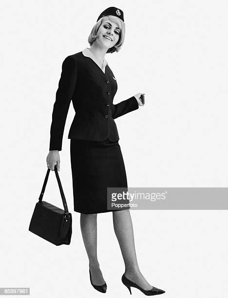 An air hostess in uniform circa 1964