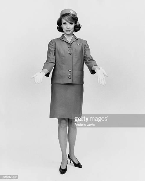 An air hostess in uniform circa 1965